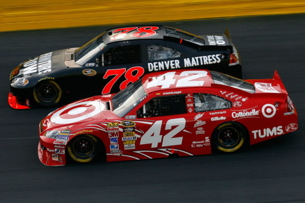 CONCORD, NC - MAY 22:  Juan Pablo Montoya, driver of the #42 Target Chevrolet, and Regan Smith, driver of the #78 Furniture Row Racing Chevrolet, race side by side during the NASCAR Sprint Showdown at Charlotte Motor Speedway on May 22, 2010 in Concord, North Carolina.  (Photo by Jason Smith/Getty Images for NASCAR) *** Local Caption *** Regan Smith;Juan Pablo Montoya