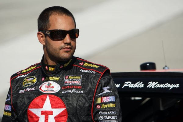 DOVER, DE - SEPTEMBER 21:  Juan Pablo Montoya, driver of the #42 Texaco/Havoline Dodge, stands next to his car on the grid during qualifying for the NASCAR Nextel Cup Series Dodge Dealers 400 at Dover International Speedway on September 21, 2007 in Dover, Delaware.  (Photo by Jonathan Ferrey/Getty Images for NASCAR)